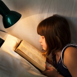 girl-reading-chapter-book-300x300